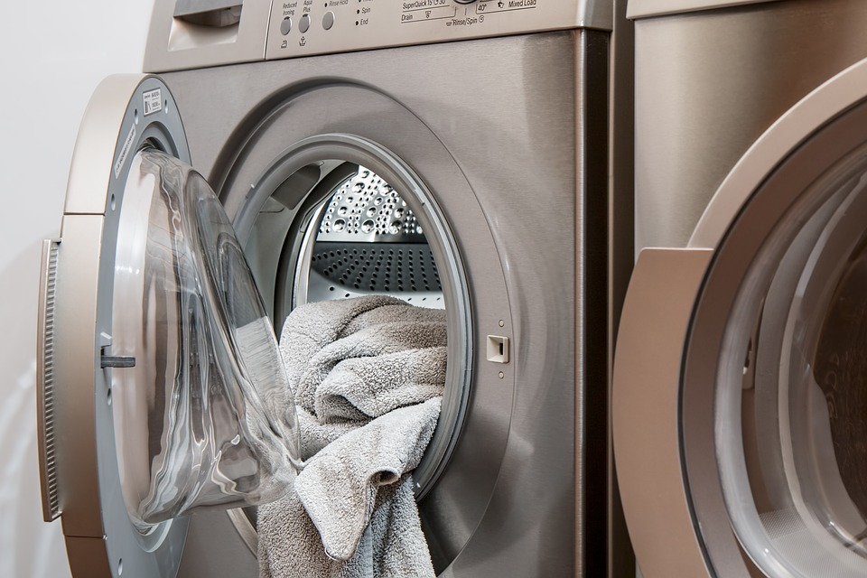 Do you want to save money on your utility bills - and save the environment at the same time? Image of washer and dryer.