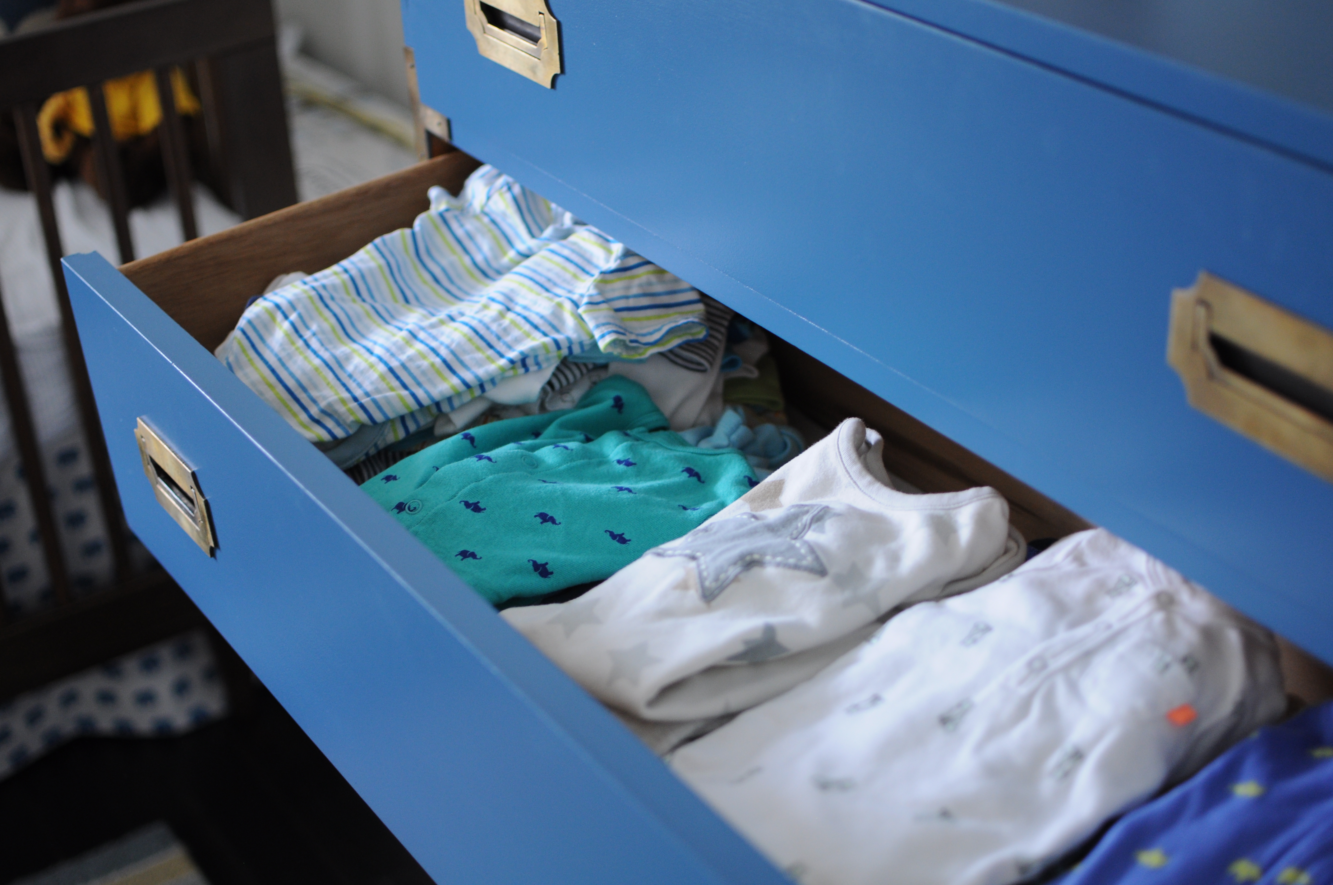 a neatly packed blue dresser