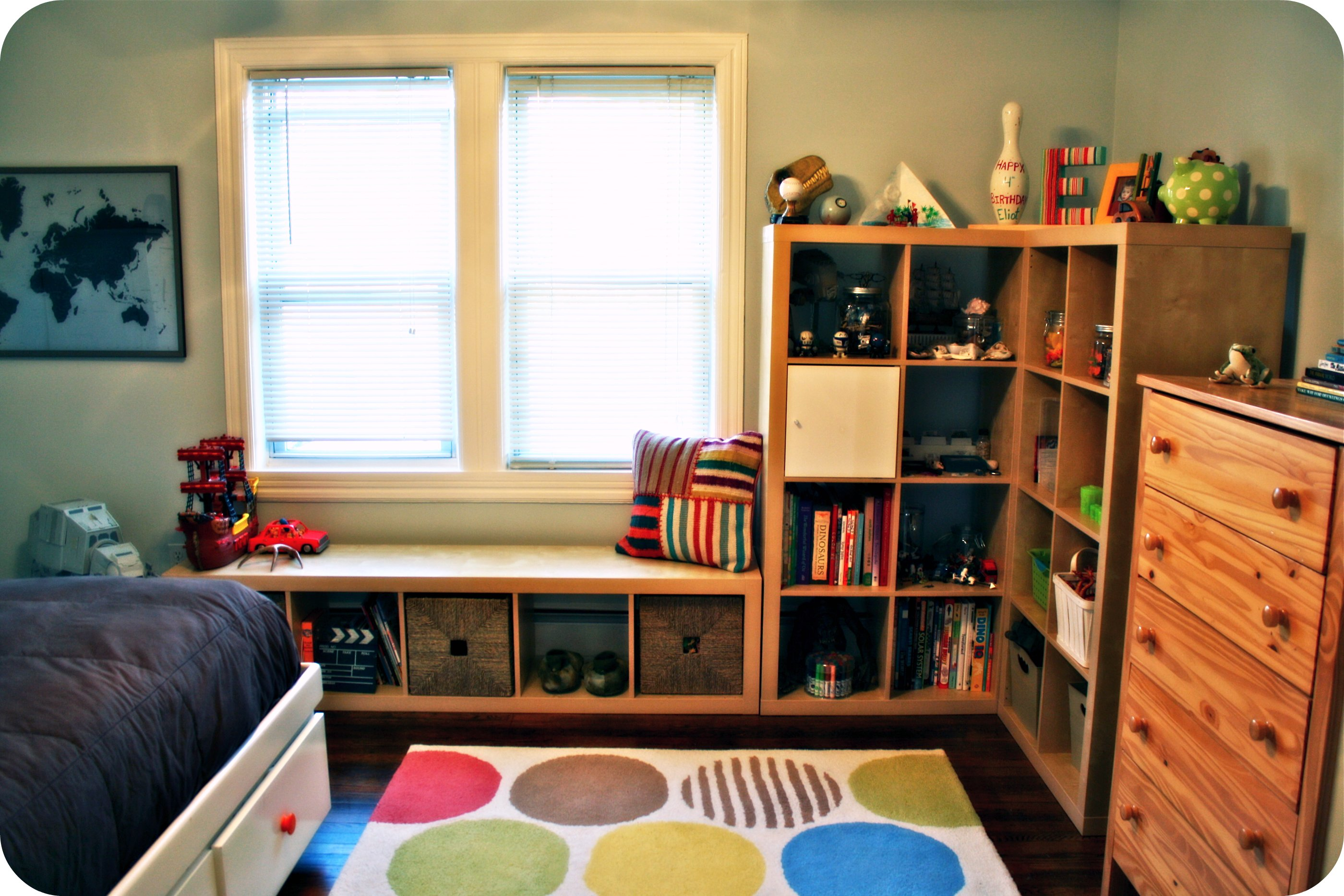 Image of a children's room neatly organized with cube shelves