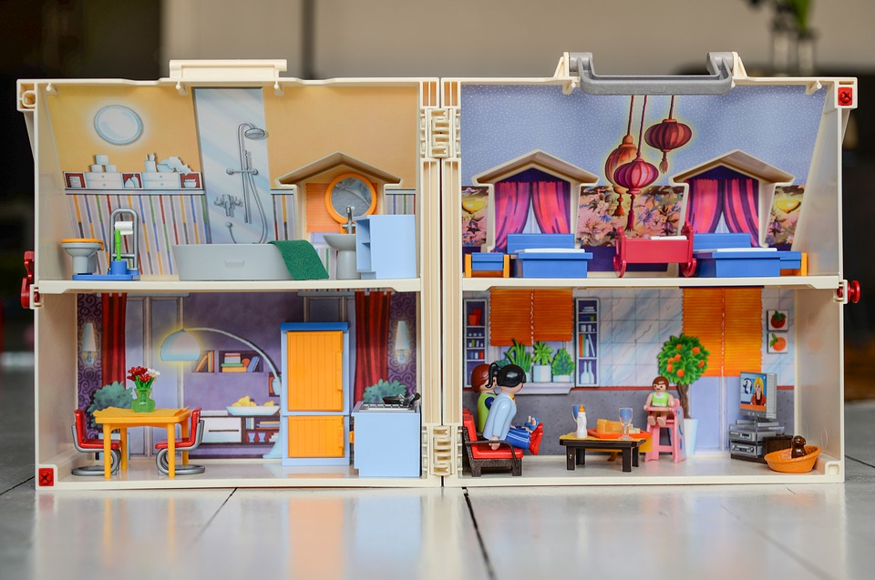 Image of the inside of a dollhouse with sectioned off rooms