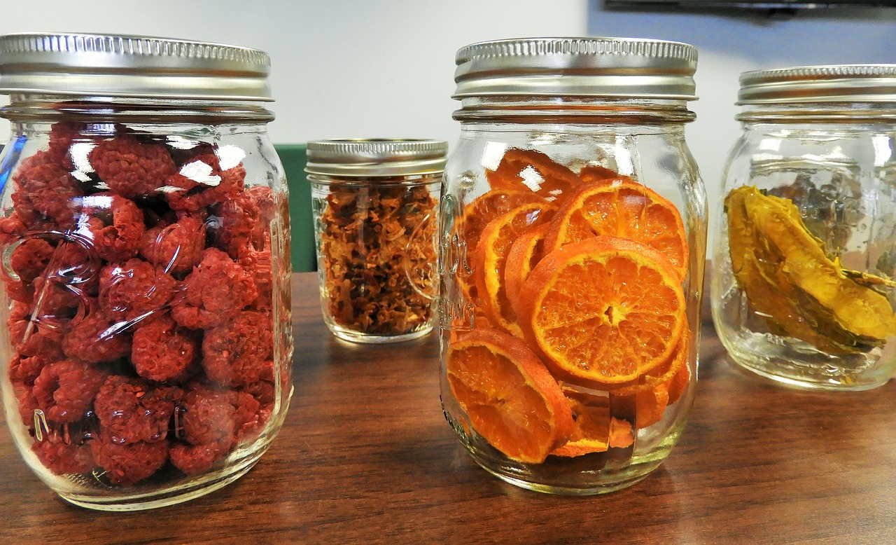 jars with different preserved fruits