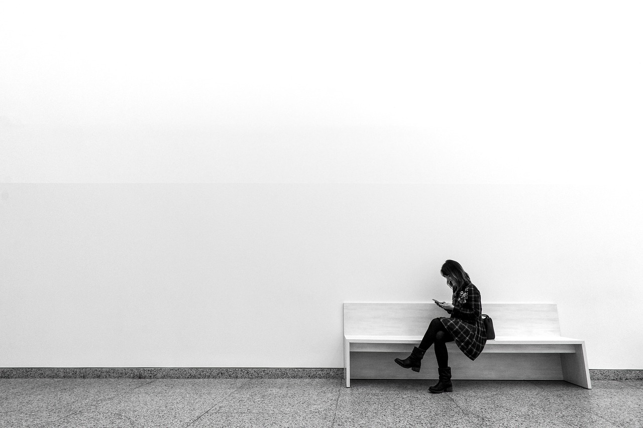 woman sitting on a bench with white backgroun