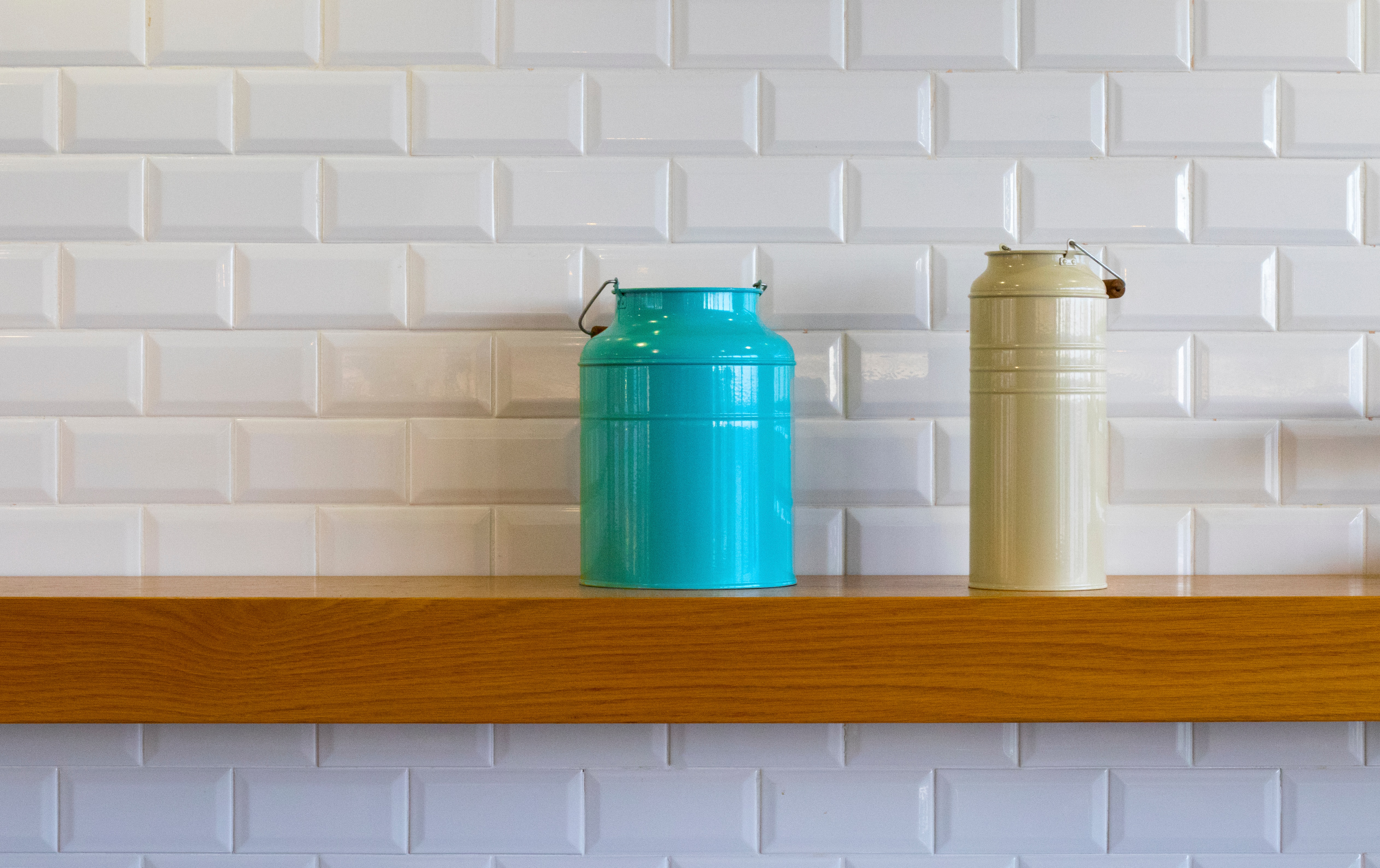 Two cans near a tiles