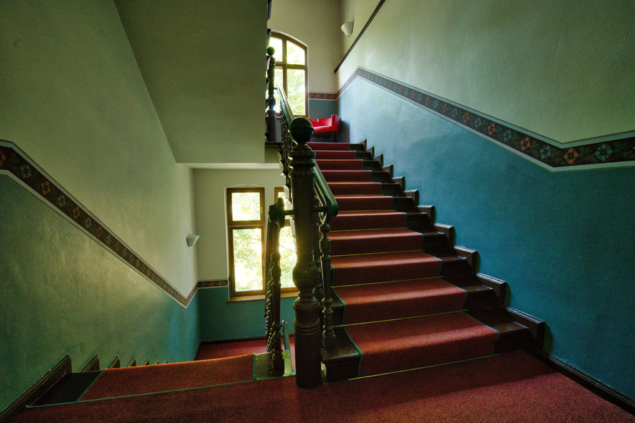 Stairs with red carpet installed