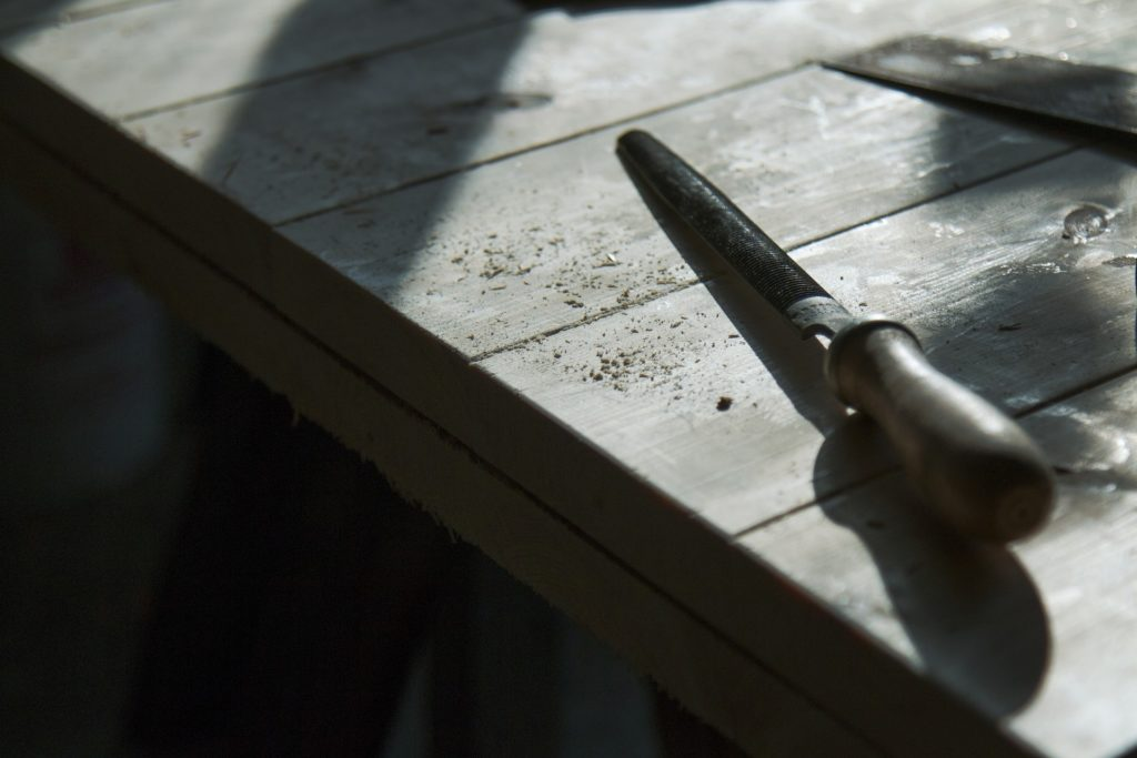 A file laying on a workbench top
